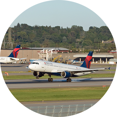 Image of a Delta jet taking off at the Twin Cities International Airport